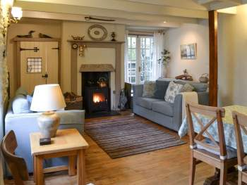 LIVING ROOM WITH DINING AREA & WOOD BURNER
