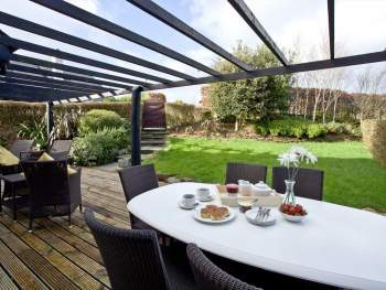 LOVELY DECKED AREA WITH TABLE AND CHAIRS