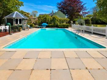 SHARED OUTDOOR SWIMMING POOL WITH BEAUTIFUL SURROUNDINGS