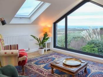 FIRST FLOOR SITTING ROOM WITH STUNNING SEA VIEWS