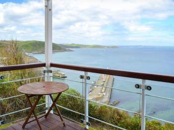 BALCONY WHICH ENJOYS AN ELEVATED POSITION OVERLOOKING THE BEAUTIFUL MEVAGISSEY BAY