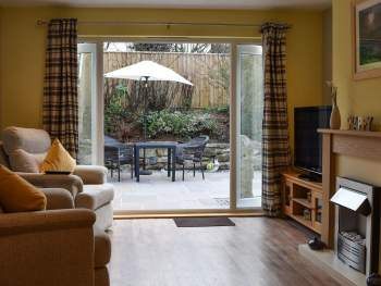 LIVING ROOM WITH PATIO DOORS