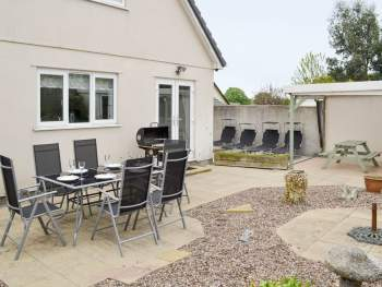REAR COURTYARD GARDEN WITH OUTDOOR FURNITURE