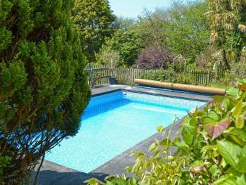 OUTDOOR HEATED SWIMMING POOL (SHARED WITH OWNER AND OTHER PROPERTIES ON-SITE)