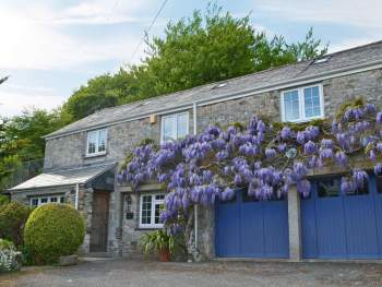 BEAUTIFUL WISTERIA-HUNG FRONTAGE