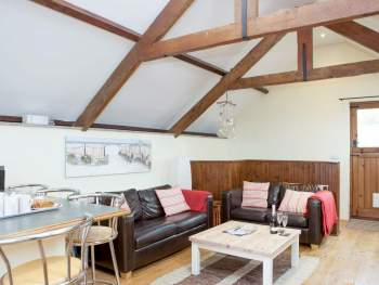 SPACIOUS OPEN PLAN LIVING SPACE WITH BEAMS