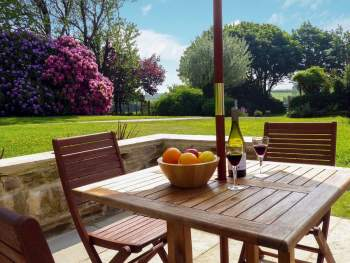 PATIO WITH GARDEN FURNITURE AND BARBECUE