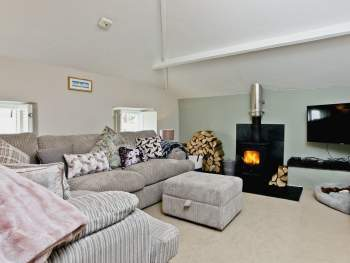 LARGE COMFORTABLE LIVING ROOM WITH COSY WOOD BURNER