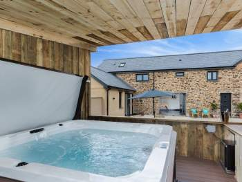 DELIGHTFUL COVERED HOT TUB