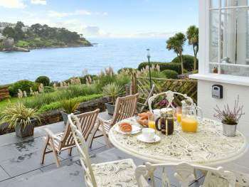 SIT OUT ON THE TERRACE AND GAZE OUT TO SEA